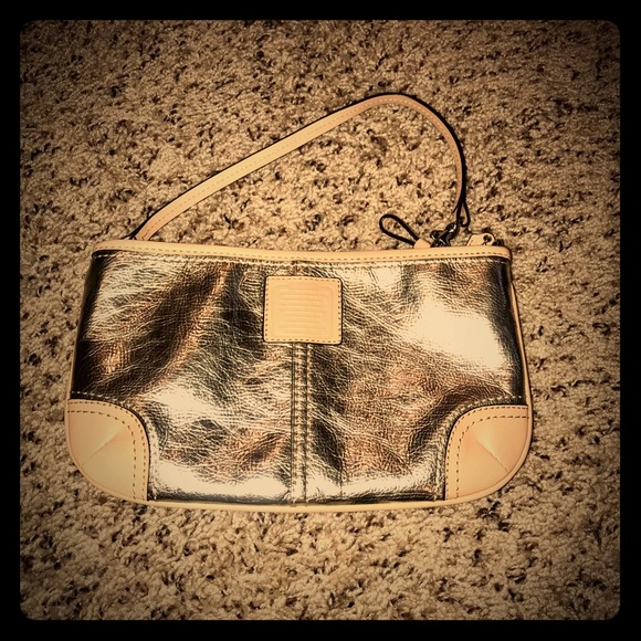 Coach Handbags - Coach Wristlet leather EUC gold silver leather